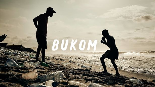 "Amsterdam Worldwide presents ""Bukom"", by Ray Demski featuring music by Mo Kolours. The film explores the vibrant Bukom neighbourhood in Accra, a legendary World Boxing Capital."