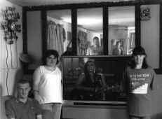 Shelby Lee Adams : Salt & Truth - Rosa Lee and Family with TV, 2006