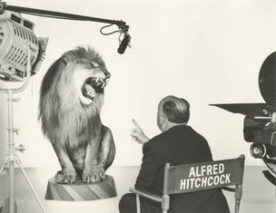 GLAMOUR OF THE GODS : Alfred Hitchcock with the MGM Lion by Clarence Sinclair Bull, 1958 (National Portrait Gallery)