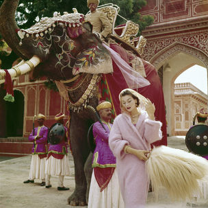 Gallery Vassie : Norman Parkinson, Anne Gunning in a Pink Mohair Coat outside the City Palace, Jaipur, India, Vogue, November, 1956
